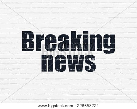 News Concept: Painted Black Text Breaking News On White Brick Wall Background