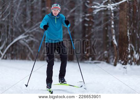Picture Of Athlete Skier At Winter Day In Forest