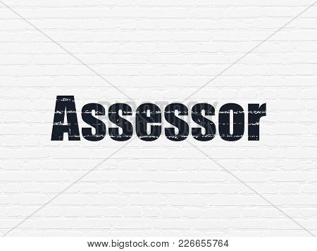 Insurance Concept: Painted Black Text Assessor On White Brick Wall Background