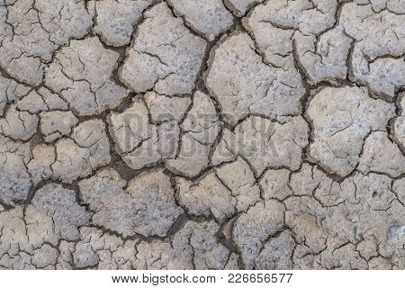 Abstract Background Or Cracked Dry Land Without Water, Dried Ground Texture