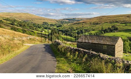 Landscape In The Yorkshire Dales, With Dent Head Viaduct In The Background, Near Cowgill, Cumbria, U