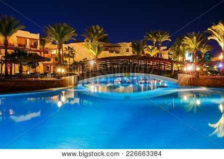 Sharma Sheikh, Egypt, October 22, 2017: Pool At Night. Blue Water And Handrails To Enter The Water.