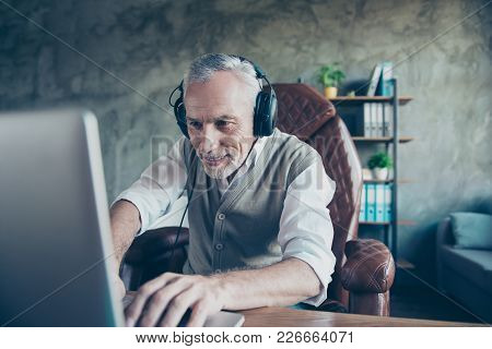 Happy Cheerful Delightful Joyful Funny Employer Is Using His Updated Computer For Playing Games And