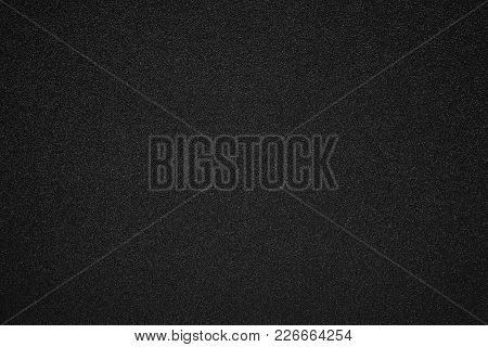 Illustration Of Abstract Speckled Grained Texture For A Background Or For Wallpaper Of Black Color