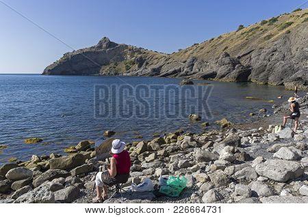 Novyy Svet, Crimea - September 2, 2017: Artists In The Open-air. Sunny Summer Morning. Little Bay In