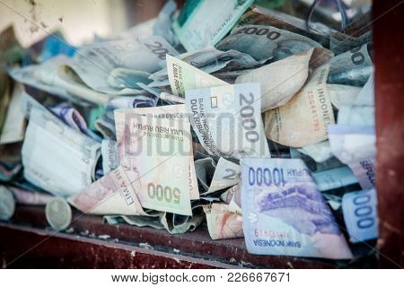 Indonesian Rupiah in a outdoor money box