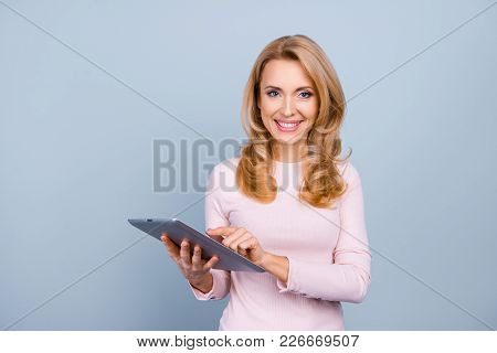 Portrait Of Cheerful Experienced Pretty Confident Woman With Stylish Curly Hairdress Holding Digital