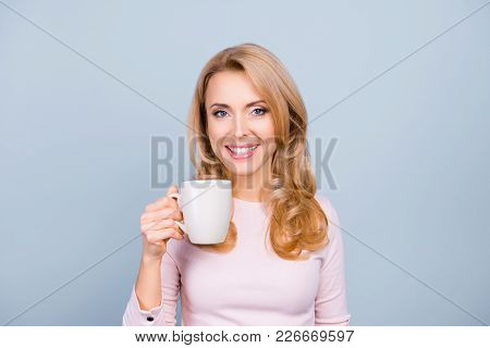 Portrait Of Beautiful Happy Adorable Lovely Attractive Woman With Curly Blonde Healthy Hair, She Is