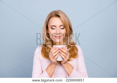 Close Up Portrait Of Satisfied Pretty Peaceful Delightful Calm Woman Is Smelling Aromatic Cacao Isol