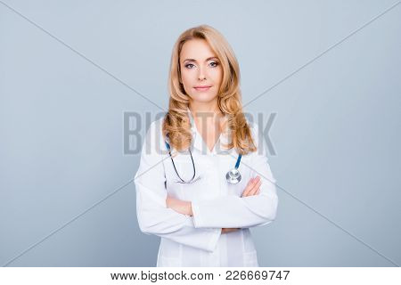 Portrait Of Attractive Doctor In White Uniform Having Stethoscope On Her Neck Standing With Crossed