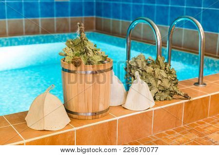 Spa Procedure, Beauty, Holidays Concept. By The Pool With Clean Water There Is Traditional Russian S