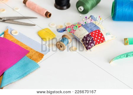 Sewing Tools, Patchwork, Tailoring And Fashion Concept - Close-up On White Work Desk In Studio, Pinc