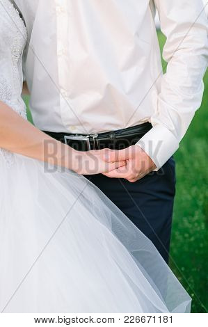 Wedding, Feelings, Relationships Concept. Close Up Of Arms Of Newly Married Woman And Man, They Are