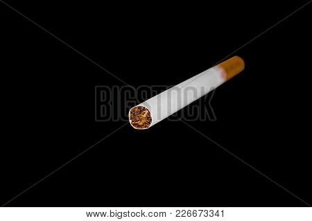 A Cigarette On A Black Background Harming The Health Of Others