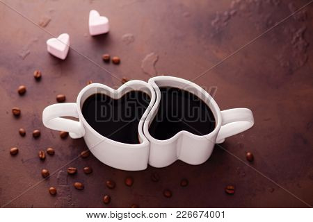 heart shape coffee with marshmallow and coffee beans - food and drink