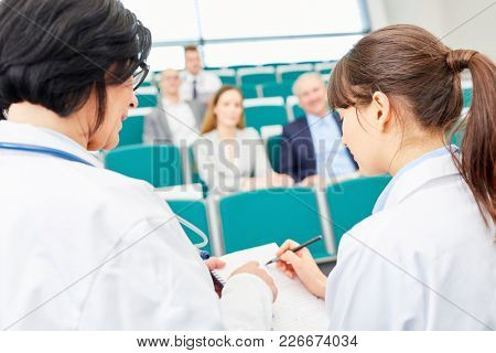 Young woman as student presenting physician exam in medical school