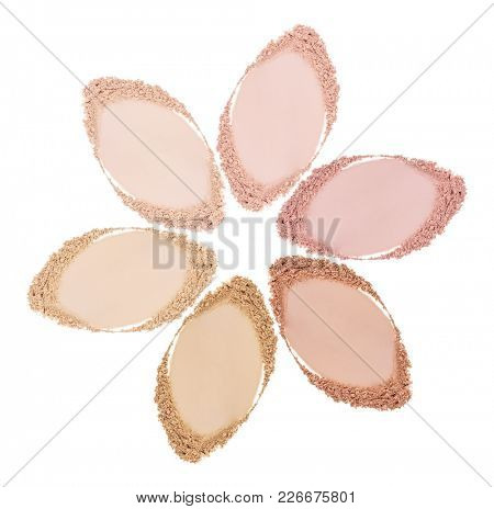 Smears of foundation for face. Conceptual flower from powder smears. Isolated on white background