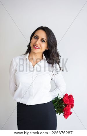 Jolly Attractive Young Business Lady Hiding Bouquet Behind Back. Cheerful Excited Pretty Woman With