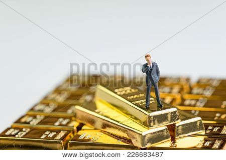 Success Finance Investment Wealth Concept, Miniature Figure Businessman Standing On Stack Of Shiny G