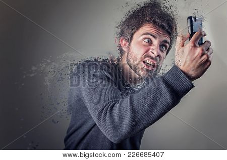 Young Man Insanely Furious Yelling At His Phone, Giving Off Steam And Smoke