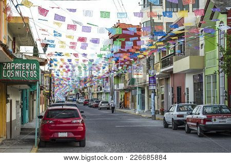 Alto Lucero, Veracruz, Mexico- January 1, 2018: Street View With Colorful Cut Paper, Cars, Stores An