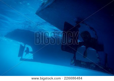 Underwater View To Yacht Rudder And Prop, Scuba Diving Concept