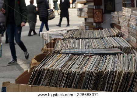 Old Gramophone Records And Books Put On Sale On Street