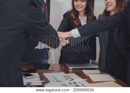 Businessman Joining United Hand, Business Team Touching Hands Together After Complete A Deal In Meet