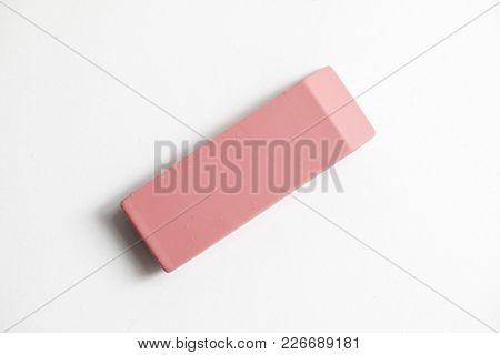 Pink Eraser Shot Up Close Against A White Background
