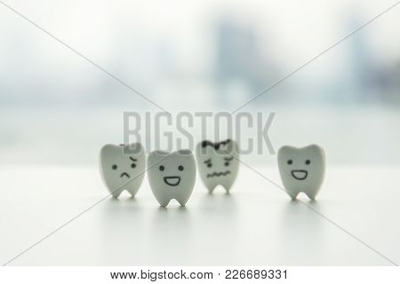 Oral Health Icon - Isolated Healthy Teeth And Decayed Teeth Cartoon With Smiley And Sad Face