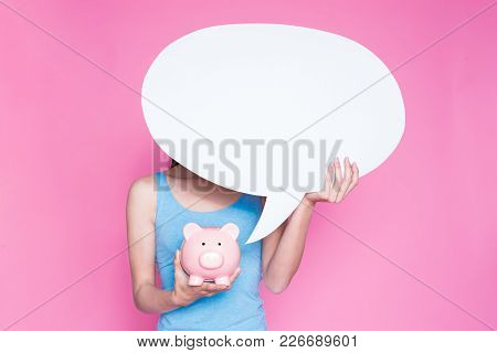 Woman Take Speech Bubble And Piggy Bank On The Pink Background