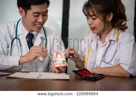 Dentist Co Worker Discussing Patient Treatment With Jaw Teeth. Orthodontist Have Meeting For Diagnos