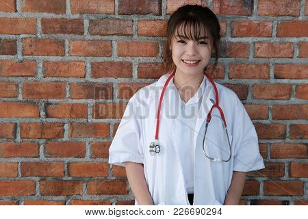 Confident Young Female Doctor Smiling At Camera.  Portrait Of  Medical Staff, Physician Or Practitio