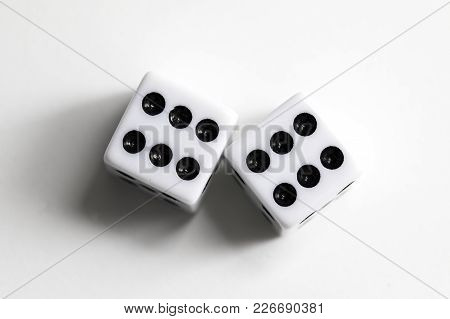 Dice Shot Up Close On A White Background, Sixes