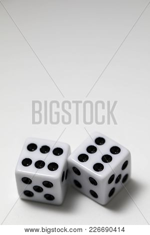 Dice Shot Up Close On A White Background,