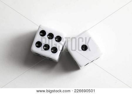 Dice Shot Up Against A White Background, Seven