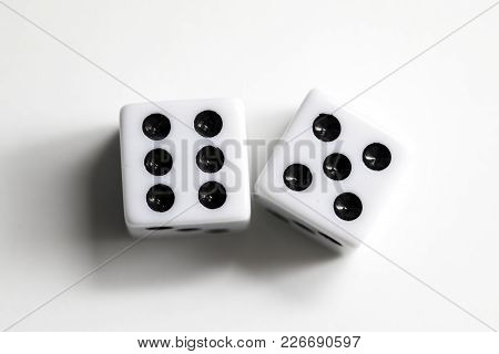 Dice Shot Up Against A White Background, Eleven