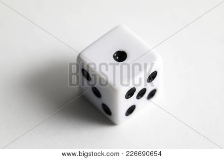 Dice Shot Up Close On A White Background, One