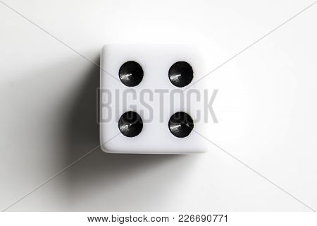 Dice Shot Up Close On A White Background, Four