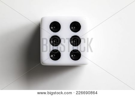 Dice Shot Up Close On A White Background, Six