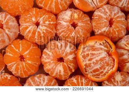 Dark Orange Round Peeled Mandarins With White Veins Along The Contours Of The Lobules.