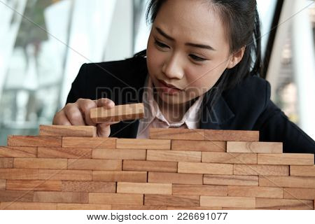 Hand Stacking Wood Block. Growth, Success & Development In Business