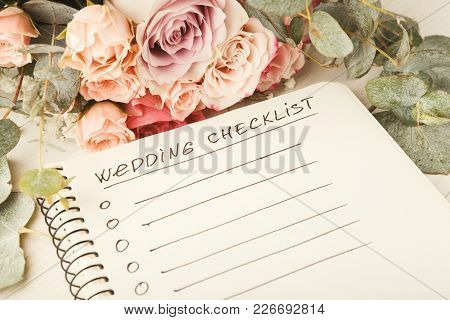Wedding Checklist With Copy Space And Rose Bouquet On The White Desktop. Marriage Planner Concept, C