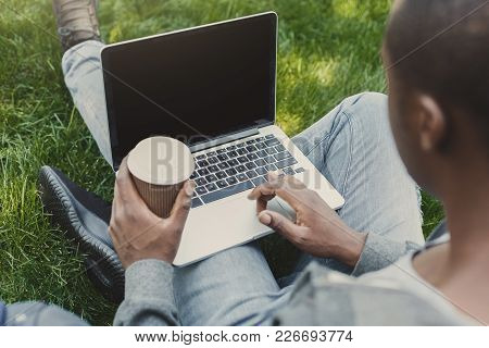 Male Hands With Laptop And Coffee Cup Closeup, Over Shoulder Shot. African-american Student Working
