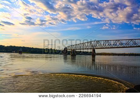 Colorful Cloudy Blue Skies Over The Chain Of Rocks Bridge Over The Mississippi  River In Pontoon Bea