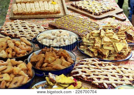 Attractive Table With Romanian Traditional Cakes At A Brunch