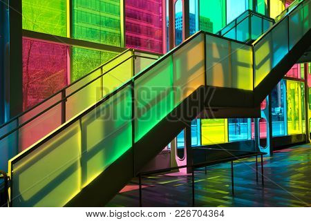 MONTREAL, CANADA - September 14, 2017: Colourful glass panels and stairs in Palais des congres de Montreal (Montreal Convention and Conference Centre)  Montreal, Canada