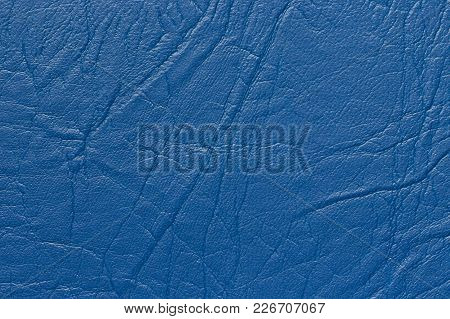 Surface Faux Leather With Creases In Blue Color As Background Or Texture.