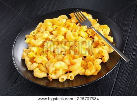 Hot Mac And Cheese On Black Plate