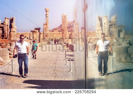 European Tourist Visiting The Old Ruins Of The Ancient Persepolis. Ancient Persia. Iran.